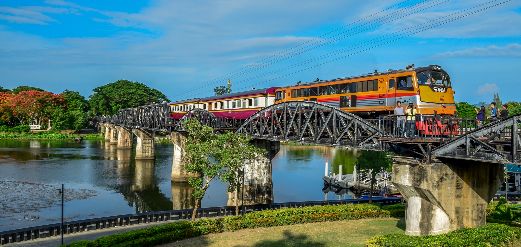 bridge on the river kwai The history of the bridge is well known, as it was part of the railway lines in world war ii and had seen its share of conflict and bloodshed after world war ii, the damaged bridge was renovated by the thai government in 1946 the bridge of the river kwai memorial week is held during late november to early december.